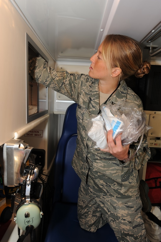 WHITEMAN AIR FORCE BASE, Mo. - Senior Airman Melissa Lerch, 509th Medical Operations Squadron aerospace medical technician, inventories medical supplies aboard the ambulance Feb. 23, 2010. Ambulance Services are on-call 24 hours a day, ready to respond to anything from an emergency landing on the airfield, to a sprained ankle at the fitness center. (U.S. Air Force photo/ Airman 1st Class Carlin Leslie)