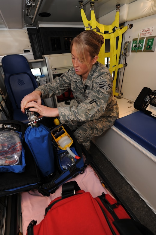 WHITEMAN AIR FORCE BASE, Mo. - Senior Airman Melissa Lerch, 509th Medical Operations Squadron, aerospace medical technician, inspects oxygen bottle levels at the beginning of her shift, Feb. 23. Ambulance Services are on-call 24 hours a day, ready to respond to anything from an emergency landing on the airfield, to a sprained ankle at the fitness center. (U.S. Air Force photo/ Airman 1st Class Carlin Leslie)