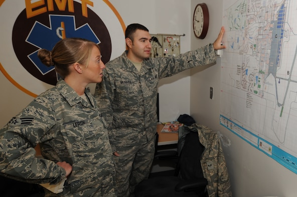 WHITEMAN AIR FORCE BASE, Mo. - Senior Airmen Melissa Lerch and Juan Vazquez, 509th Medical Operations Squadron aerospace medical technicians, review a base map to ensure they know the exact location of buildings on base to provide quick response, Feb. 23, 2010. The Ambulance Services flight operates on a 24 hours on, 48 hours off shift, supplying services to emergency calls as needed on and off-base. (U.S. Air Force photo/ Airman 1st Class Carlin Leslie)