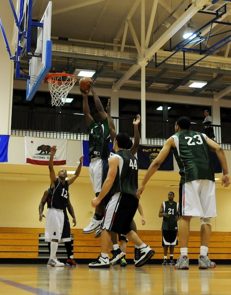 RAF MILDENHALL, England – Jonnie Story, 100th Maintenance Group, dunks the basketball during the  Intramural Basketball Championship game at the Hardstand Gym Feb. 18. (U.S. Air Force photo/ Staff Sgt. Jerry Fleshman)
