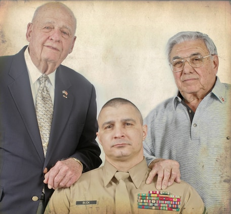 "Larry Pinto, left, and Angelo Ciotta, stand over Sergeant Major Gary Buck, 1st Marine Corps District sergeant major. 1st MCD hosted a number of veterans from the battle of Iwo Jima including Pinto and Ciotta for an all-hands event with his Marines, Feb. 23, 2010. ""The common bond we share is that we fought for our country. We embrace each other's willingness to serve,"" he said. (Official Marine Corps photo by Cpl. Clifton Sams, illistration by Sgt. Randall A. Clinton)"