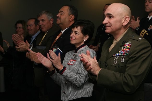 Marines, sailors and civilians clap as two memorandums are signed by key leadership from Marine Corps Installations East, and U.S. Marine Corps Forces, Special Operations Command and the University of North Carolina Feb. 24, at the MARSOC headquarters building auditorium. The memorandums signify a collaborative agreement between three organizations.