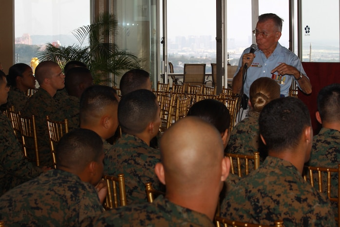 Retired Master Gunnery Sgt. Robert E. Talmadge, The Chosin Few's Aloha Chapter president, gives a Korean War presentation to service members with U.S. Marine Corps Forces, Pacific, Feb. 25 at the Sunset Lanai, Camp H.M. Smith, Hawaii. Talmadge was a supply sergeant with 1st Engineer Battalion, 1st Marine Division, during the Korean War.