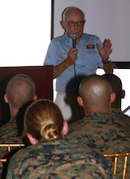 """Retired Navy Capt. Charles """"Davy"""" Crockett, a member with The Chosin Few, Aloha Chapter, gives a Korean War presentation to service members with U.S. Marine Corps Forces, Pacific, Feb. 25 at the Sunset Lanai, Camp H.M. Smith, Hawaii. Crockett was a Pilot during the Korean War."""