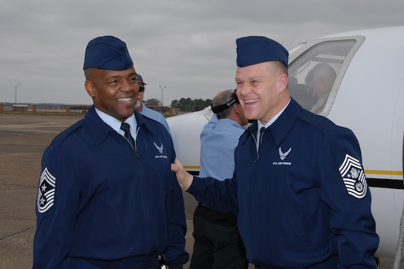 Chief Master Sgt. Brye McMillon, Air University command chief, greets Chief Master Sergeant of the Air Force James Roy on his arrival to Maxwell Air Force Base, Feb. 22. (Official Air Force Photo by Henry Hancock)