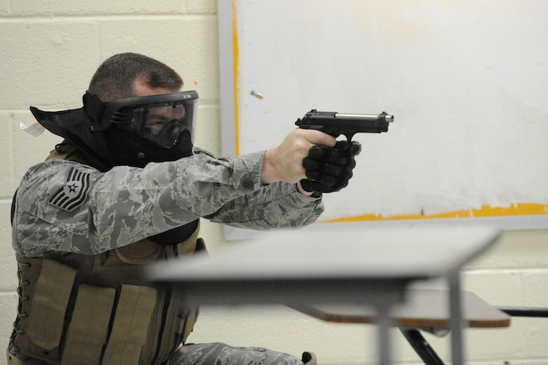 U.S. Air Force Tech. Sgt. Chad Murphy opens fire on a perpetrator during a clearing room exercise while attending the Active Shooter Training Course in Mt. Pleasant, S.C., Feb. 23, 2010. The AST course prepares first responders on how to react to a hostile situation.  Sergeant Murphy is the Non-Commissioned Officer in Charge of Operations with the 628th Security Forces Squadron. (U.S. Air Force photo by James M. Bowman/released)