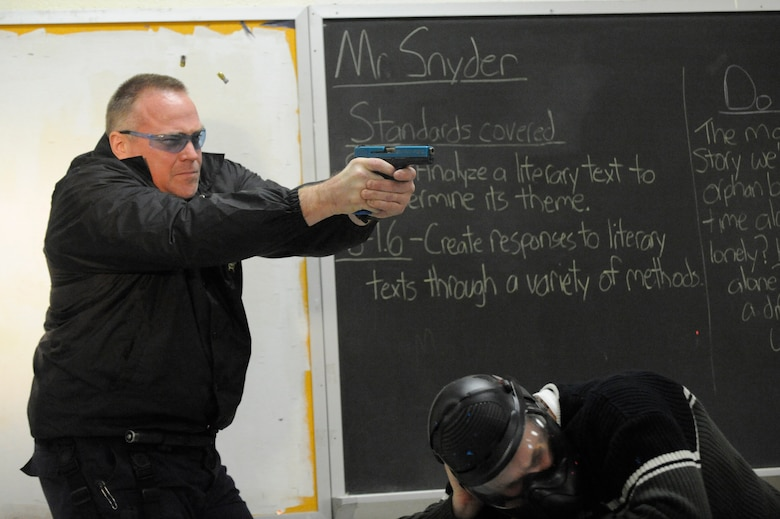 Don Kjellman opens fire on an perpetrator during a clearing room exercise while attending the Active Shooter Training Course in Mt. Pleasant, S.C., Feb. 23, 2010. The AST course prepares first responders on how to react to a hostile situation. Mr. Kjellman is a Deputy Sheriff with the Charleston County Sheriff Department. (U.S. Air Force photo by James M. Bowman/released)