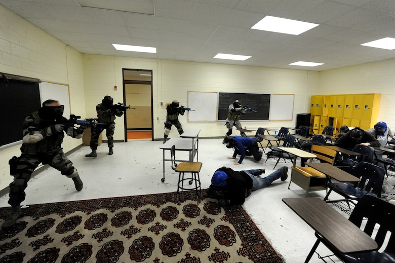 U.S. Air Force security forces members clear a room during a mock hostage exercise while participating with the Active Shooter Training Course in Mt. Pleasant, S.C., Feb. 23, 2010. The AST course prepares first responders on how to react to a hostile situation. (U.S. Air Force photo by James M. Bowman/released)