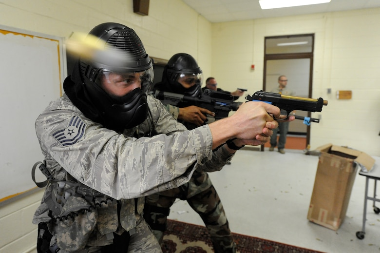 U.S. Air Force Tech. Sgt. Chris Stenke opens fire on a perpetrator during a clearing room exercise while participating in the Active Shooter Training Course at Mt. Pleasant, S.C., Feb. 23, 2010. The AST course prepares first responders on how to react to a hostile situation. Sergeant Stenke is the NCOIC of training with the  61st Security Forces Squadron at Los Angeles Air Force Base. (U.S. Air Force photo by James M. Bowman/released)