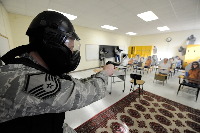 U.S. Air Force Master Sgt. David Dalbec, clears a room during the Active Shooter Training Course in Mt. Pleasant, S.C., Feb. 23, 2010. The AST course prepares first responders on how to react to a hostile situation. Sergeant Dalbec is an combat arms instructor with the 148th Fighter wing Duluth, Minn. (U.S. Air Force photo by James M. Bowman/released)