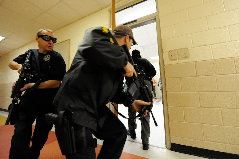 Dennis rushes into a room to clear the area during the Active Shooter Training Course at Mt. Pleasant, S.C., Feb. 23, 2010. The AST course prepares first responders on how to react to a hostile situation. Dennis is with the U.S. Marshals Service in Charleston, S.C. (U.S. Air Force photo by James M. Bowman/released)