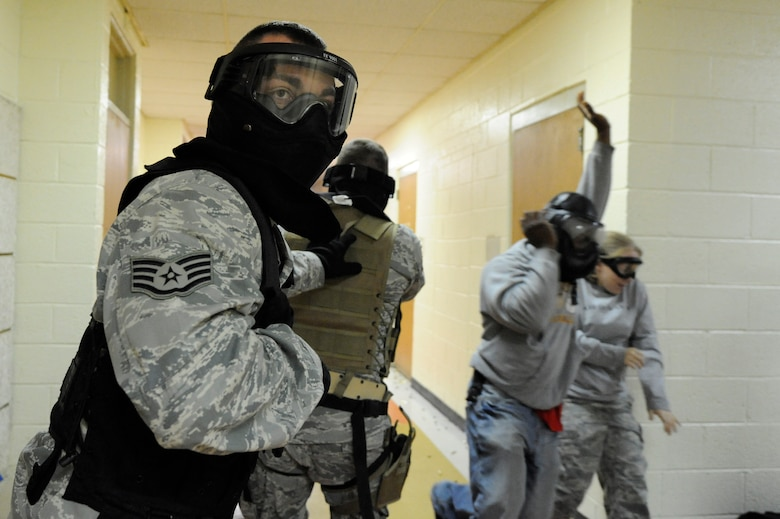 U.S. Air Force Staff Sgt. Brady Frazier provides rear cover during a hallway clearing scenario during the Active Shooter Training Course at Mt. Pleasant, S.C., Feb. 23, 2010. The AST course prepares first responders on how to react to a hostile situation. (U.S. Air Force photo by James M. Bowman/released)