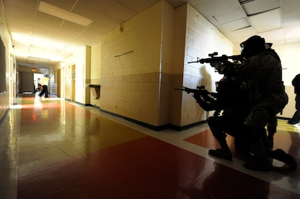 Security forces members prepare to shoot an aggressor during the Active Shooter Training Course at Mt. Pleasant, S.C., Feb. 23, 2010. The AST course prepares first responders on how to react to a hostile situation. (U.S. Air Force photo by James M. Bowman/released)