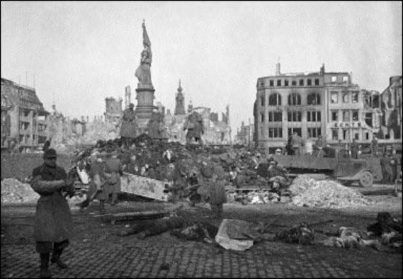 """The aftermath of the bombing shows an apocalyptic scene as the city residents attempt to pick through the rubble.  Despite the destruction, it's key to remember the city was part of the Nazi war-production machine and """"precision targeting"""" had a different definition in 1944 than it does today. (Courtesy photo)"""