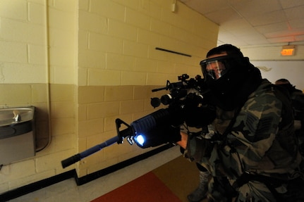 U.S. Air Force Tech. Sgt. Bradley Krause performs a hallway clearing during a mock hostile situation during the Active Shooter Training Course at Mt. Pleasant, S.C., Feb. 23, 2010. The AST course prepares first responders on how to react to a hostile situation. Sergeant Krause is with the 50th Security Forces Squadron and is the Non-commissioned officer in charge of training he is stationed at Schriever Air Force Base, Colo. (U.S. Air Force photo by James M. Bowman/released)