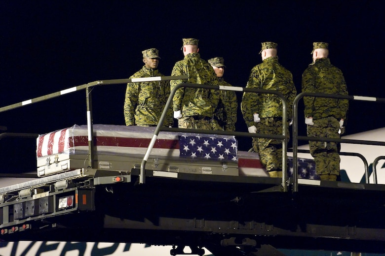 A U.S. Marine Corps team transfers the remains of Marine Corps Lance Cpl. Adam D. Peak, of Florence, Ky., at Dover Air Force Base, Del., February 23. Lance Cpl. Peak was assigned to 2nd Battalion, 2nd Marine Regiment, 2nd Marine Division, II Marine Expeditionary Force, Camp Lejeune, N.C. (U.S. Air Force photo/Roland Balik)