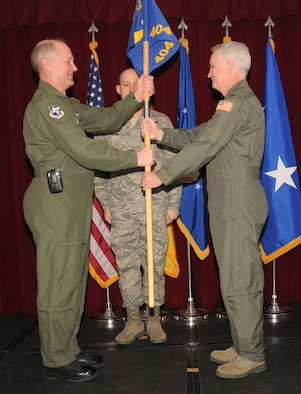 Maj. Gen. Ronald Ladnier, 17th Air Force (Air Forces Africa) commander, hands the guidon to the new commander of the 404th Air Expeditionary Group, Col. Phillip Fallin, during a change of command ceremony Feb. 25 at the Ramstein Community Center. Colonel Fallin takes command from Col. Jeffrey MacDonald, who led the group from September 2009. The 404th AEG provides intratheater airlift support for U.S. Africa Command taskings. (U.S. Air Force photo by Staff Sgt. Stefanie Torres)