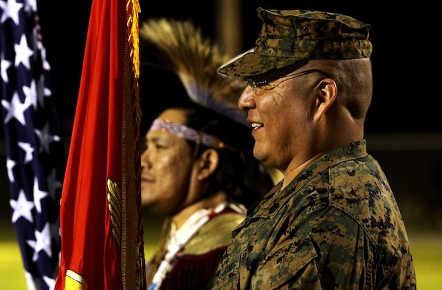 "Staff Sgt. James L. Eagleman, former 1st Marine Division tanker and current resident at Wounded Warrior Battalion West, bears the Corps colors during ""Operation One Drum's"" closing ceremony at Camp Pendleton, Feb. 25. American Indians from across the nation embraced nearly 30 combat veterans during a four-day workshop designed to alleviate combat stress."