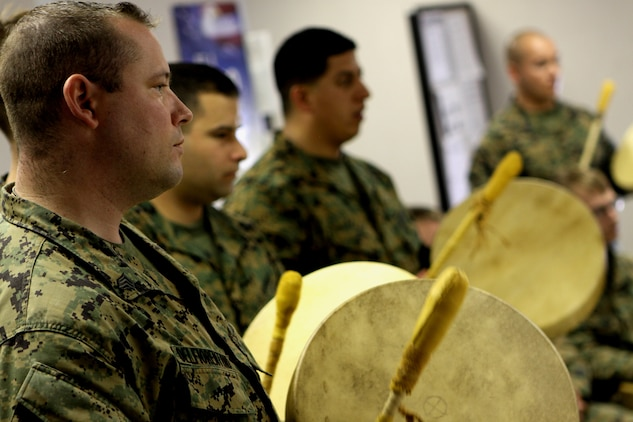 "Sgt. Brandon W. Delfiorentino, resident, Wounded Warrior Battalion West, plays a hand-made drum he put together during ""Operation One Drum's"" closing ceremony at Camp Pendleton, Feb. 25. American Indians from across the nation embraced nearly 30 combat veterans during a four-day workshop designed to alleviate combat stress."