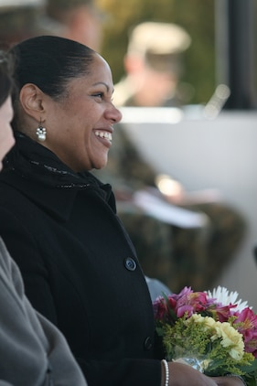 The wife of Sgt. Maj. Efren Whitehead, outgoing sergeant major of 8th Engineer Support Battalion, Combat Logistics Regiment 25, 2nd Marine Logistics Group, smiles in the crowd during a post and relief ceremony where Whitehead was relieved by Sgt. Maj. Veney Cochran aboard Camp Lejeune, N.C., Feb. 26, 2010.  Whitehead was the 8th ESB sergeant major since January 2006.  Cochran was previously the sergeant major of Headquarters & Headquarters Squadron aboard Marine Corps Air Station Cherry Point, N.C. (U.S. Marine Corps photo by Cpl. Patrick P. Evenson)
