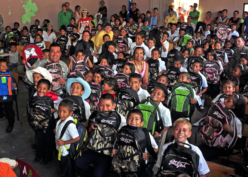 Honduran children show off their new backpacks that were passed out in rural areas of Honduras by members of Soto Cano Air Base, Honduras in conjunction with the Give a Kid a Backpack organization Feb. 24. More than 1,000 backpacks were passed out from Feb. 23-26. (U.S. Air Force Photo/Staff Sgt. Bryan Franks)