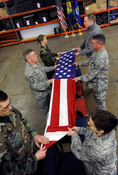 Oregon Air National Guardsmen practice folding a flag during 4 days of Honor Guard training at the Portland Air Naional Guard Base on February 24th, 2010.  (U.S. Air Force photograph by SSgt John Hughel, 142nd Fighter Wing Public Affairs)