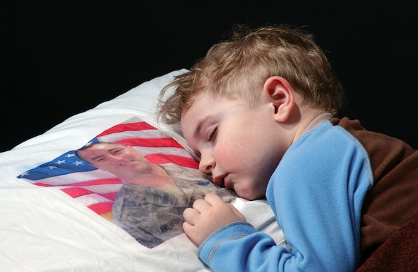 This photograph of 3-year-old Blain Lawlor won the portrait/personality photo category in the 2009 Air Force Reserve Command Media Contest. It was also named best stand-alone photo in the annual competition. The Airman and Family Readiness Center at Westover Air Reserve Base, Mass., created the pillowcase for Blain, so he could keep his dad, Master Sgt. Dan Lawlor, close during a deployment to Iraq. (U.S. Air Force photo/Staff Sgt. Hueming Mui)