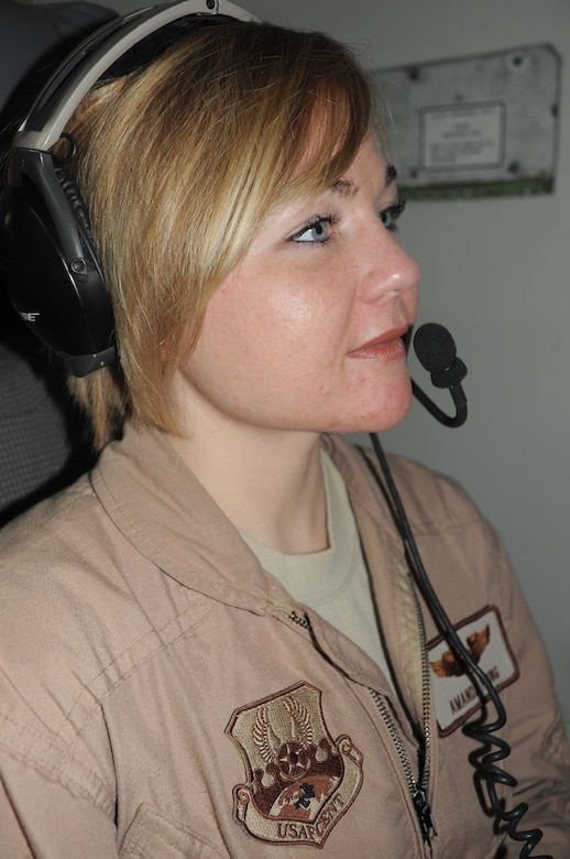 Capt. Amanda Young, an E-3 Sentry Airborne Warning and Control System aircraft air surveillance officer with the 965th Expeditionary Airborne Air Control Squadron, flies on a deployed E-3 air mission in Southwest Asia on Feb. 16, 2010. Captain Young is deployed from Tinker Air Force Base, Okla., and her hometown is Austin, Texas. (U.S. Air Force Photo/Master Sgt. Scott T. Sturkol/Released)