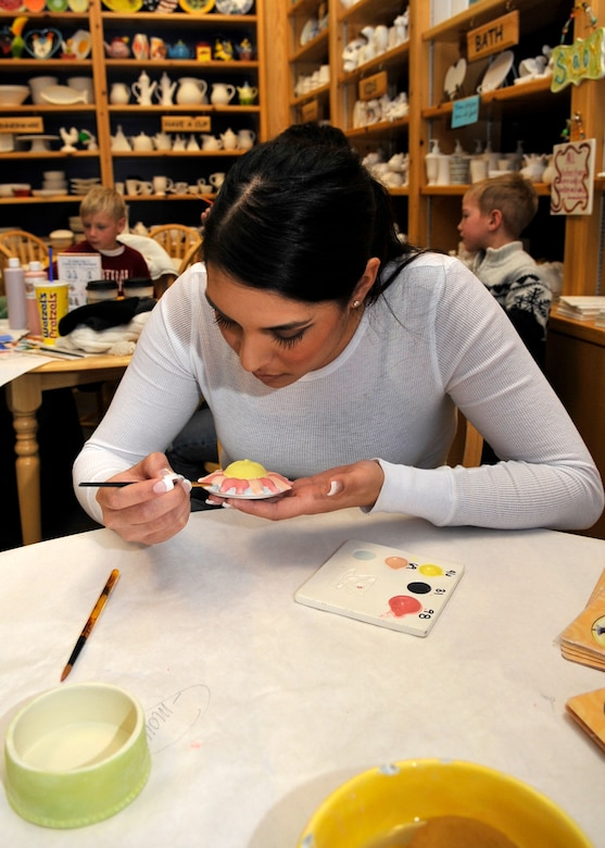 AURORA, Colo. -- Airman 1st Class Manisha Vasquez brightens up her art at a local arts and crafts shop. Several such locations are available in the Denver Metro Area, most within a short drive from Buckley Air Force Base. (U.S. Air Force photo by Airman 1st Class Paul Labbe)