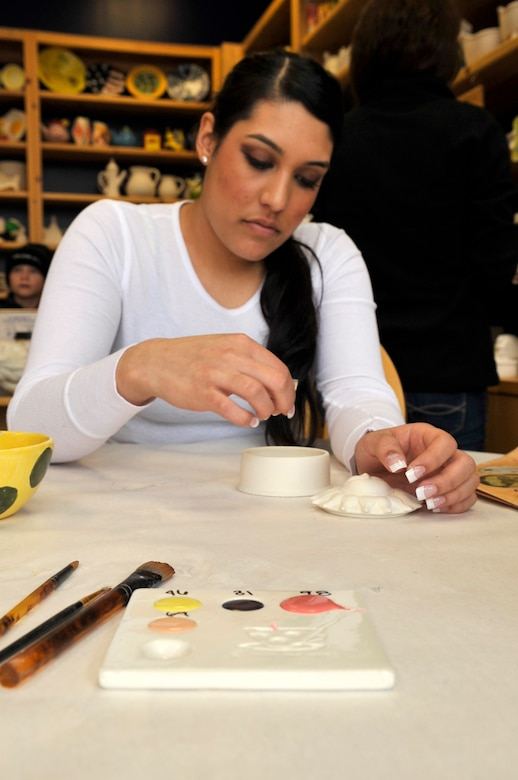 AURORA, Colo. -- Airman 1st Class Manisha Vasquez begins the process of cleaning out her pottery to paint at a local arts and crafts shop. (U.S. Air Force photo by Airman 1st Class Paul Labbe)