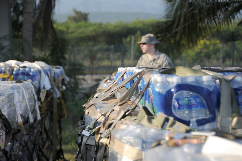 Tech. Sgt. Matthew Skeens from the Kentucky National Guard?s 123rd Contingency Response Group conducts an inventory of water at an air hub in Barahona, Dominican Republic,  Jan. 24. The water is to be shipped to earthquake victims in Haiti. (U.S. Air Force photo by Tech. Sgt. Dennis Flora)