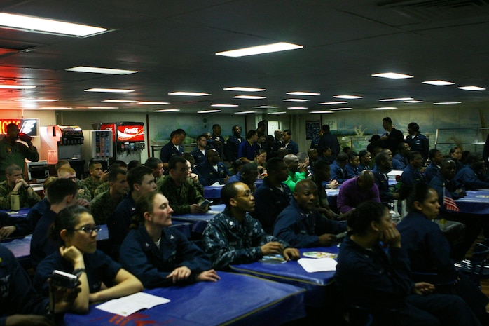 More than 100 Marines and sailors with the 31st Marine Expeditionary Unit (MEU) and Essex Amphibious Ready Group (ARG) attended a ceremony in honor of Black History Month on the mess deck of the forward-deployed amphibious assault ship USS Essex (LHD 2), Feb. 27.