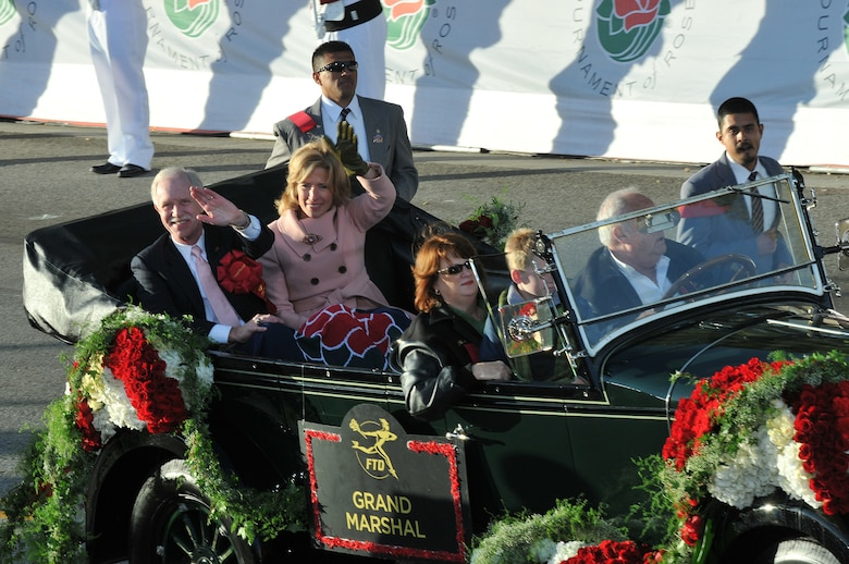 "The year's Grand Marshal Capt. Chesley B. ""Sully"" Sullenberger waves to the crowd during the Tournament of Rose Parade, Jan 1. The US Airways pilot was honored for saving the lives of everyone aboard an Airbus A320 during an emergency landing on the Hudson River. (Photo by Atiba S. Copeland)"
