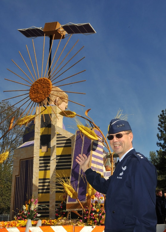 Lt. Gen. Tom Sheridan, Space and Missile Systems Center commander, checks out a Rose Parade float topped by a GPS satellite model, Dec. 31. All floats in the parade are covered with flowers, seeds and other plant materials. It takes hundreds of volunteer man-hours to decorate the floats.   (Photo by Lou Hernandez)