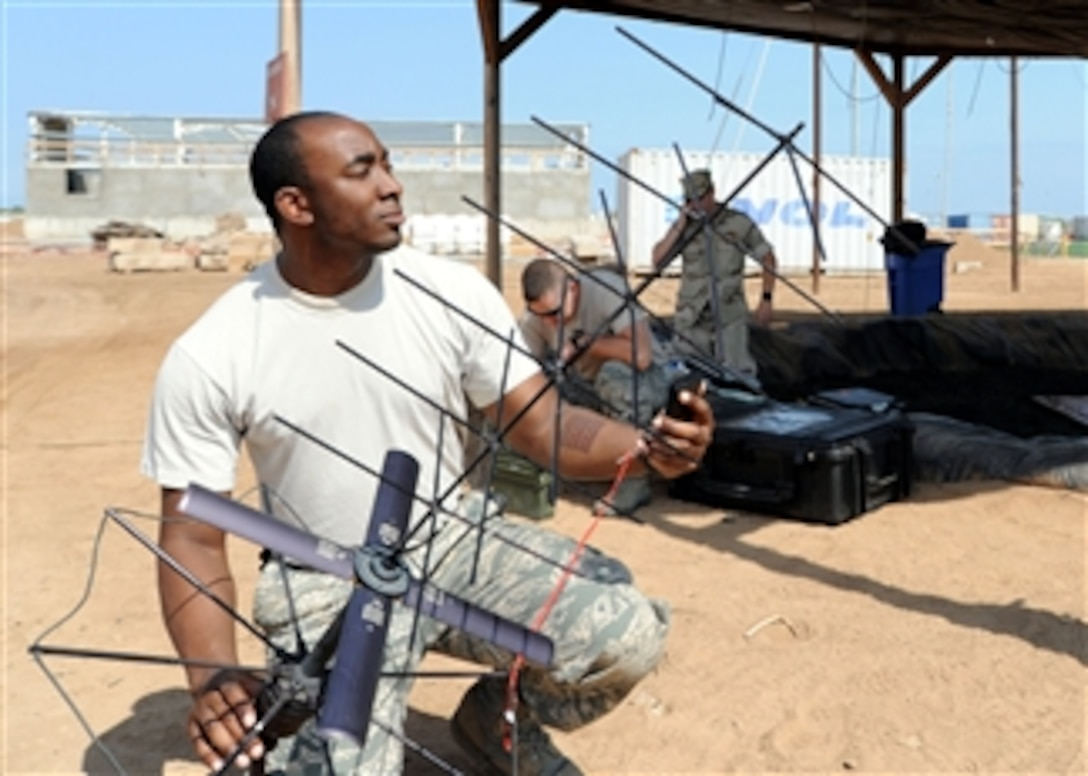 U.S. Air Force Senior Airman Carl Johnson sets up a PRC-117 tactical satellite during training at Camp Lemonier, Djibouti, on Dec. 29, 2009.  Hands-on training gives personnel the skills necessary to install, operate and maintain these systems in realistic field environments.