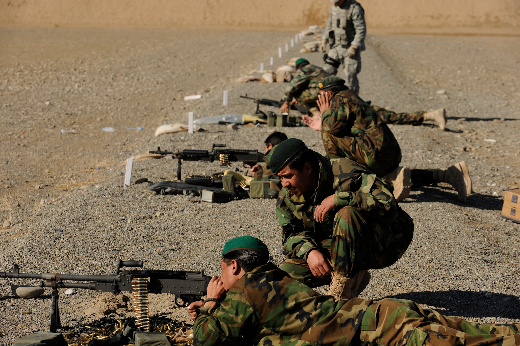 Afghanistan National Army Air Corps soldiers engage targets with  M-240B machine guns during weapons familiarization training in Kandahar, Afghanistan, Jan. 4, 2010.  The Afghan soldiers are training with 738th Air Expeditionary Advisory Group Airmen to gain the skills needed to fulfill security requirements independently.  (U.S. Air Force photo/Staff Sgt. Manuel J. Martinez/Released)
