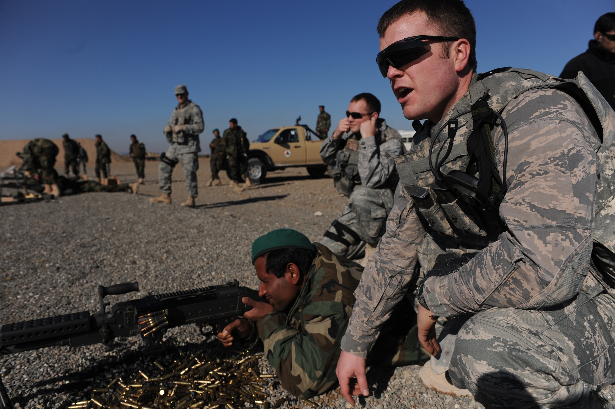 Tech. Sgt. Joshua Ray, 738th Air Expeditionary Advisory Group Security Forces advisor, gives an Afghanistan National Army Air Corps soldier feedback during M-240B machine gun familiarization training in Kandahar, Afghanistan, Jan. 4, 2010. Sergeant Conley is deployed from Fairchild Air Force Base, Wash., in support of Operation Enduring Freedom. (U.S. Air Force photo/Staff Sgt. Manuel J. Martinez) (Released)