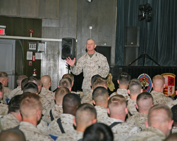 Lt. Gen. Dennis Hejlik, commanding general of II Marine Expeditionary Force, speaks with Marines during a town hall meeting at the theater aboard Al Asad Air Base, Iraq, Jan. 6, 2010. During the meeting, Hejlik expressed his gratitude for the hard work of the Marines deployed with II MEF (Forward).