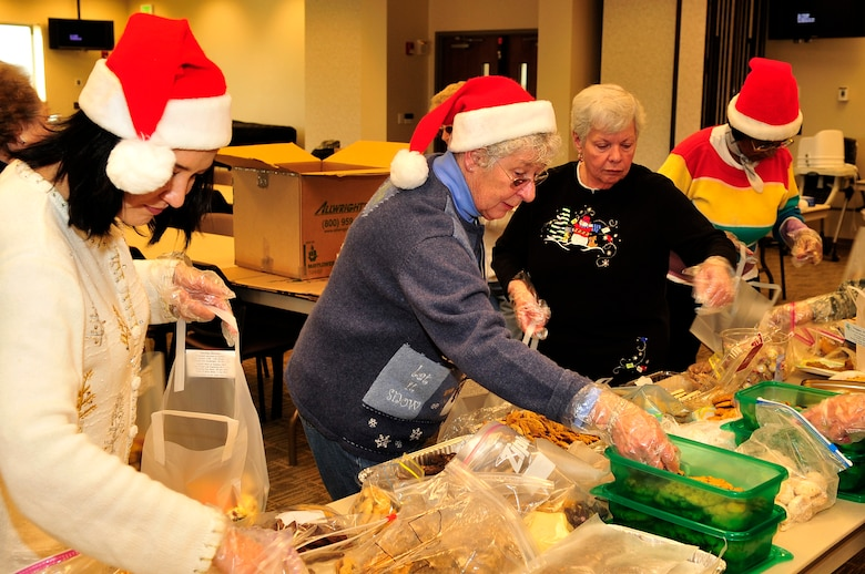 BUCKLEY AIR FORCE BASE, Colo. -- Volunteers Ann Wheless, Barb Ciesluk, Joyce Langer and Ann Burgess aid in bagging cookies for the annual cookie caper at the base chapel Dec. 15, 2009. 154 dozen bags were made and delivered to dorm residents. (U.S. Air Force Photo by Airman 1st Class Manisha Vasquez)