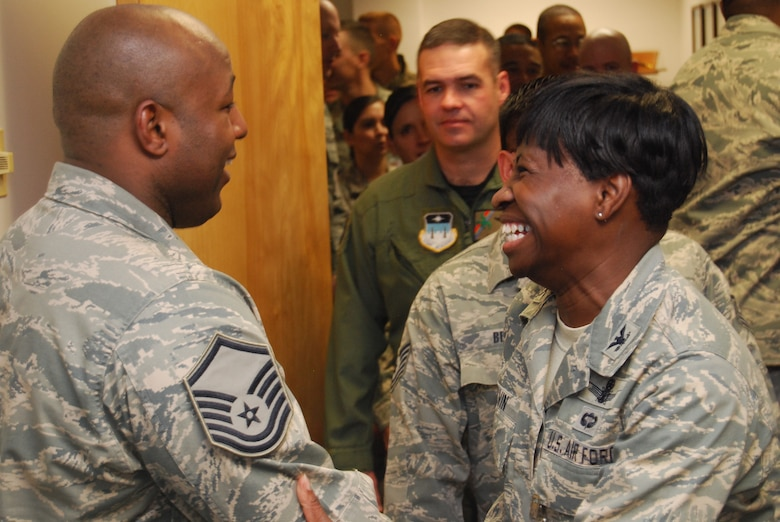 Col. Gail Colvin congratulates Master Sgt. Bryant Ward on receiving a promotion to master sergeant through the Stripes for Exceptional Performers program Dec. 22, 2009. Sergeant Ward, an AMT with Cadet Squadron 04, is the Air Force Academy's sole STEP promotee for 2009. Colonel Colvin is the vice commandant of cadets for culture and climate. (U.S. Air Force photo/Staff Sgt. Don Branum)