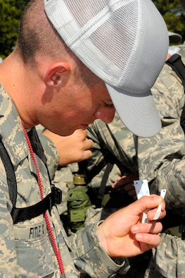 Air Force Academy Cadet 4th Class Kyle Fitle checks his temperature using a disposable thermometer during Basic Cadet Training at the Academy's Jacks Valley July 13, 2009. The cadet population was screened for influenza-like symptoms after more than 150 cadets were diagnosed with the H1N1 flu virus. (U.S. Air Force photo/Dave Ahlschwede)