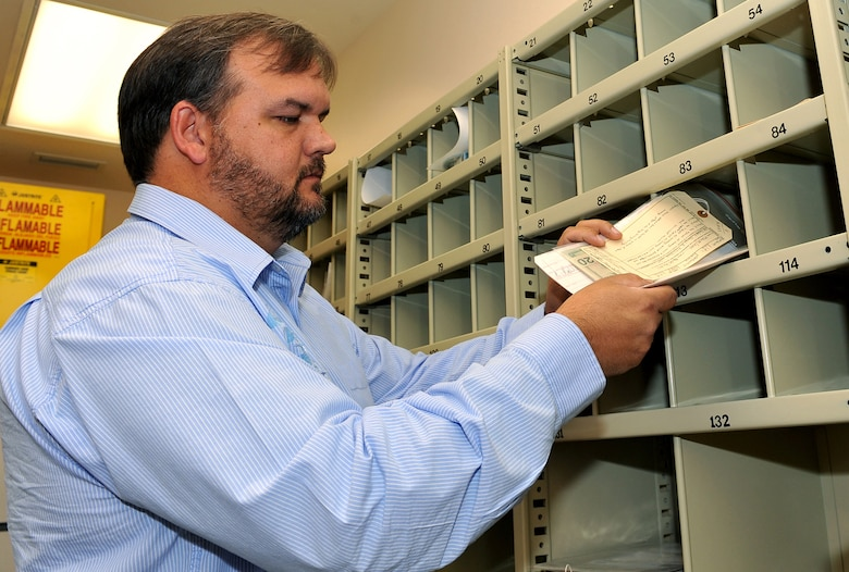 OFFUTT AIR FORCE BASE, Neb. -- Corey D. Zimmer, chief of criminal investigations with the 55th Security Forces Squadron, checks in evidence inside Bldg. 160 here on Dec. 7, 2009. The criminal investigation section is a three man team that investigates a variety of crimes including theft, assault and drug related incidents. 