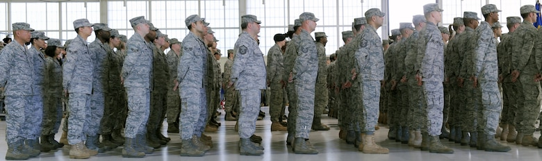 LANGLEY AIR FORCE BASE, Va. – Airmen stand in formation during the 633d Air Base Wing activation and change-of-command ceremony. The activation of the 633d ABW is the first step in fulfilling congress' 2005 Base Realignment and Closure decision that forms Joint Base Langley-Eustis later this month.(U.S. Air Force photo/Airman 1st Class John Teti)