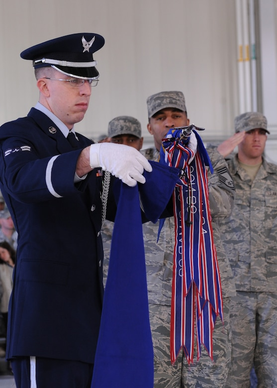 LANGLEY AIR FORCE BASE, Va. – Airman 1st Class Scott Tice, 633d Medical Group, surgical technician, covers the 633d Medical Group guidon flag during the 633d Air Base Wing activation and change-of-command ceremony. The activation of the 633d ABW is the first step in fulfilling congress' 2005 Base Realignment and Closure decision that forms Joint Base Langley-Eustis later this month.(U.S. Air Force photo/Airman 1st Class John Teti)
