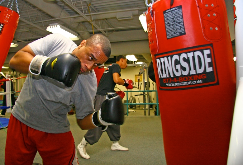 Boxer Will Gilbert hones his technique on a punching bag at the new Tinker All Services Boxing Team workout facilities Jan. 6. The Fitness Center West now houses the team's new amenities, which include a full-size ring, punching bags and sport-specific training equipment. The elite facility opened Dec. 17 and also includes new cardio and resistance-training equipment available to all Airmen. (Air Force photo by John Stuart)
