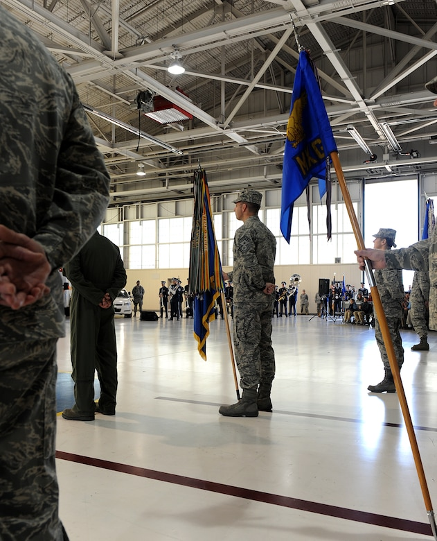 LANGLEY AIR FORCE BASE, Va. --  Command Chief Master Sgt. Kevin Jurgella, 1st Fighter Wing command chief, stands at parade rest with the 1st Fight Wing guidon during the 633d Air Base Wing activation and change-of-command ceremony.  The activation of the 633d ABW is the first step in fulfilling congress' 2005 Base Realignment and Closure decision that forms Joint Base Langley-Eustis later this month. (U.S. Air Force photo/Senior Airman Zachary Wolf)