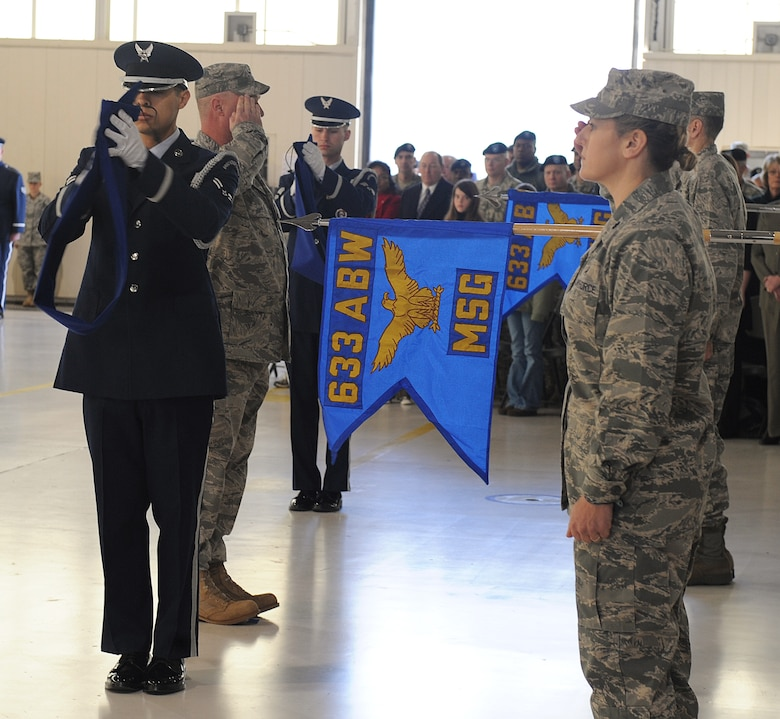 LANGLEY AIR FORCE BASE, Va. -- The 633d Medical Group and the 633d Mission Support Group receive their new guidons during the 633d Air Base Wing activation and change-of-command ceremony.  The activation of the 633d ABW is the first step in fulfilling congress' 2005 Base Realignment and Closure decision that forms Joint Base Langley-Eustis later this month. (U.S. Air Force photo/Senior Airman Zachary Wolf)