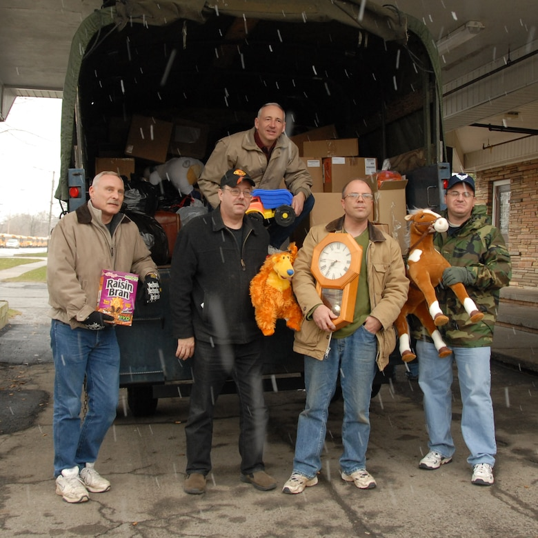Members from the 107th Airlift Wing once again answered the call. For the 21st consecutive year members graciously donated countless bags of clothing, toys and food. (Left to right) Master Sgt. Duane Bores, Master Sgt. Mark Lewandowski, Tech. Sgt. Paul Wiegand, Master Sgt. Roger Clark and Master Sgt. Steven Buja up on truck. (U.S. Air Froce Photo/ Tech Sgt. Cathy Perretta)