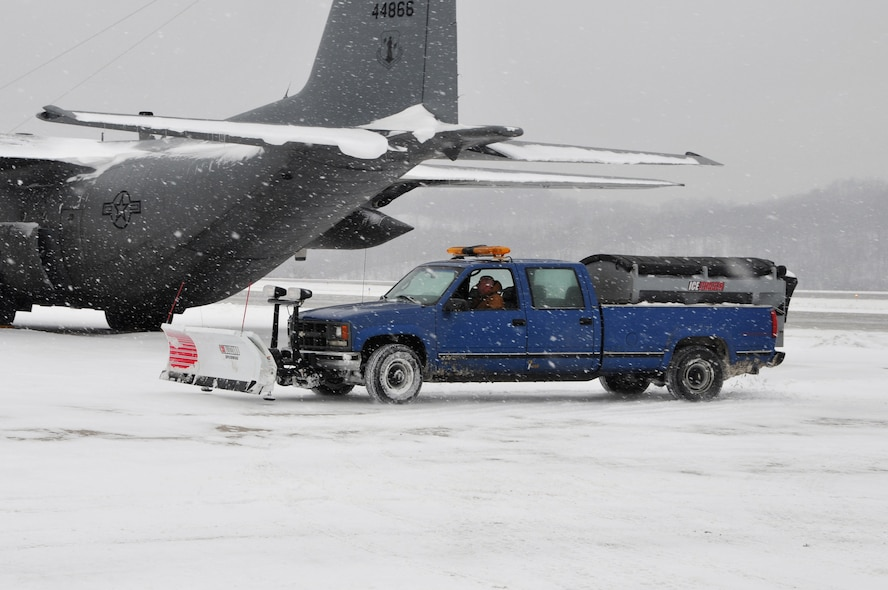 Civilian Tom McBurney, a state employee in operations and maintenance at Yeager Airbase, Charleston, W.Va., works to remove snow, Tuesday, Jan. 5, 2010. State employees worked extended hours to remove snow and keep 130th Airlift Wing of the West Virginia Air National Guard operations up and running. Snow and emergency service started December 2010 and operations and maintenance has accrued nearly 300 hours of overtime. (U.S. Air Force photo by Staff Sgt. William Hinamon/Released)