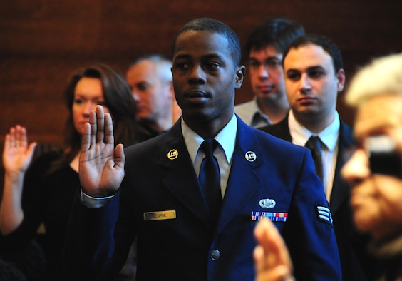 NIAGARA FALLS AIR RESERVE STATION, NY--Senior Airman Christopher George, 914 Airlift Wing, takes an oath of allegiance as part of a naturalization ceremony to signify United States citizenship. SrA George is originally from Guyana, South America.  (U.S. Air Force photo by Staff Sgt Stephanie Clark) (Released)